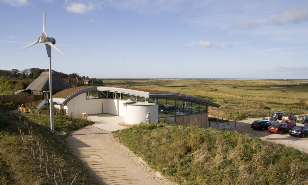 Timber clad building with curved green roof