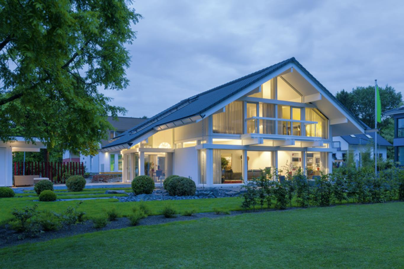 Image of pitched roof home in evening