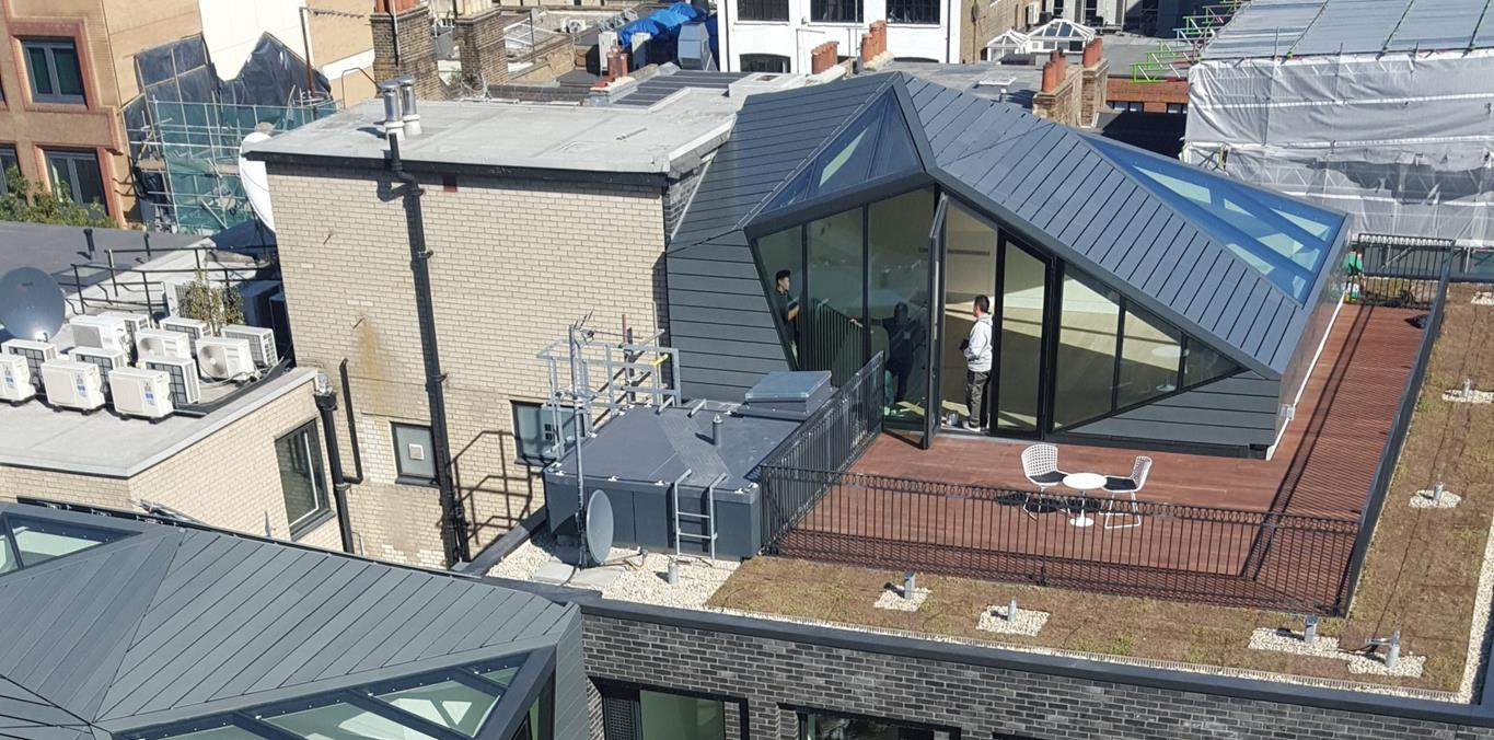Flat roof on building with decking and chairs