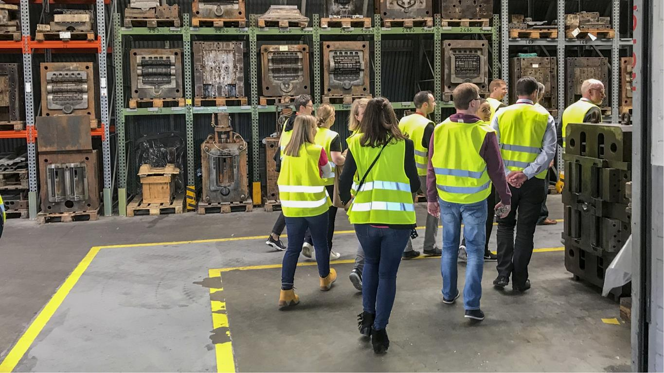 BMI staff touring a manufacturing facility