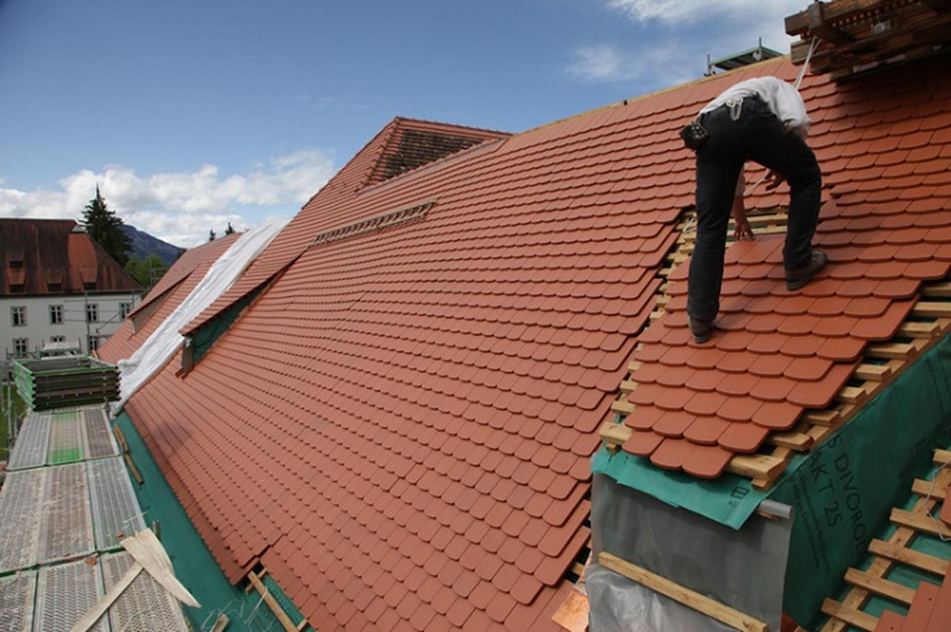 Trader working on a pitched roof